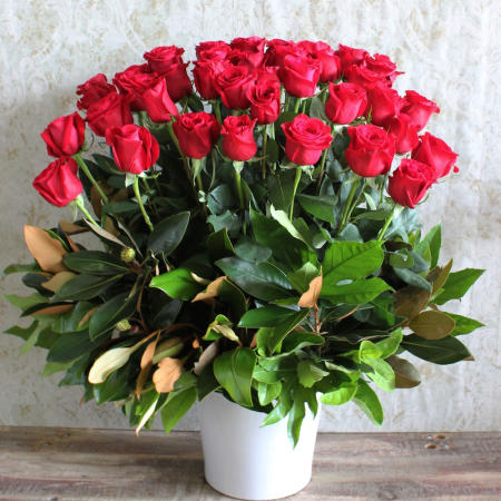 Image of an Arrangement of long stemmed red roses in a ceramic pot delivered by local Sydney florist