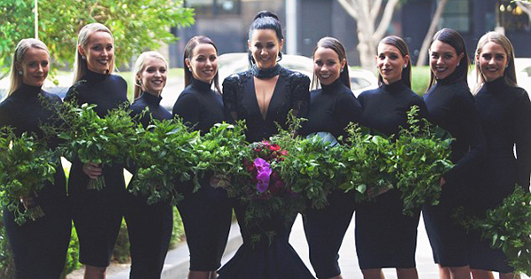 The bridesmaids carried bouquets made entirely of greenery.